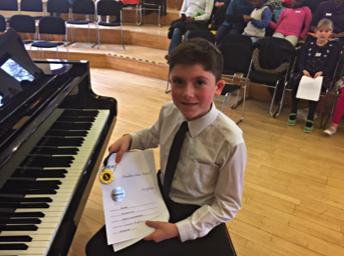 Alex wins piano competition